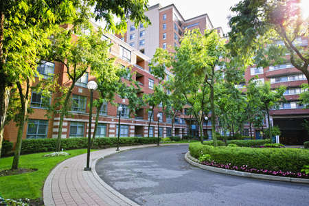 Circular driveway and sidewalk at brick condominium building