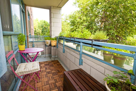 balcony: Balcony of condo with patio furniture and plants