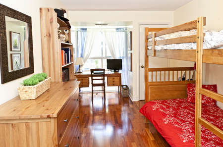 Student bedroom with hardwood floor and bunk beds - artwork is from photographer portfolio photo
