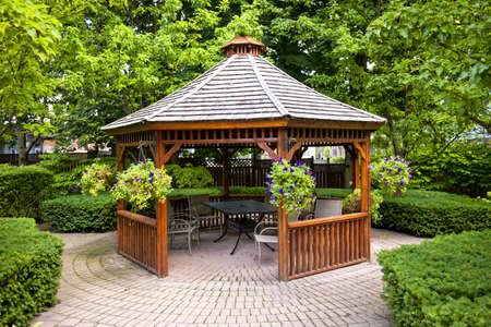 Gazebo in landscaped garden with interlocking stone patio photo
