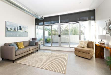 living room sofa: Living room with sliding glass door to balcony - artwork from photographer portfolio
