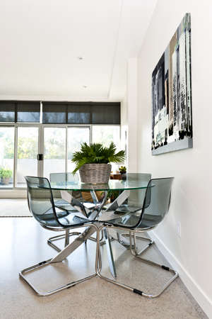 Dining table and chairs in loft apartment - artwork from photographer portfolio photo