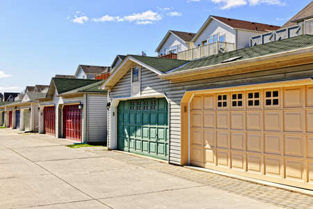 car in garage: Row of garage doors at parking area for townhouses