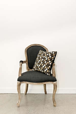 Antique armchair furniture with cushion against white wall Stock Photo - 15898190