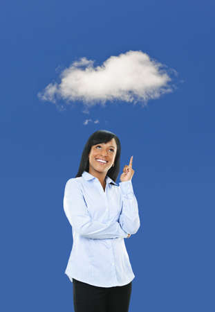 Smiling black woman thinking about cloud computing