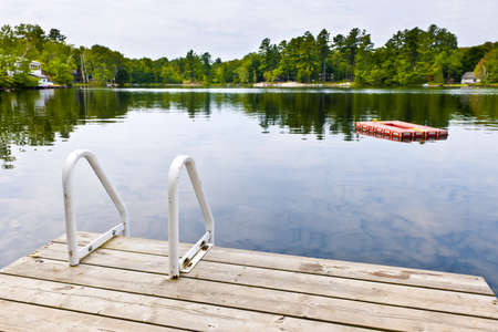 Dock and ladder on summer lake with diving platform in Ontario Canada Stock Photo - 15898717