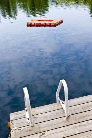 Dock and ladder on summer lake with diving platform in Ontario Canada Stock Photo - 15898740