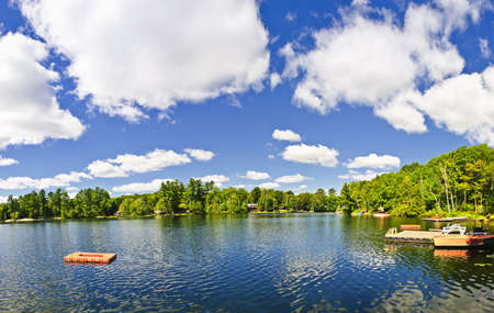 Beautiful lake with dock and diving platform in Ontario Canada cottage country Stock Photo - 15898743
