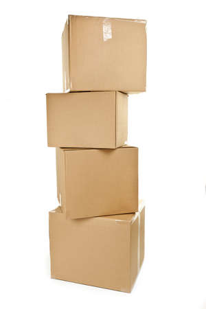 Stack of four large cardboard moving boxes isolated on white