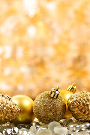 Golden Christmas background with ornaments and pine cones Stock Photo - 16419108