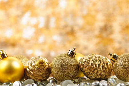 Golden Christmas background with ornaments and pine cones Stock Photo - 16419116