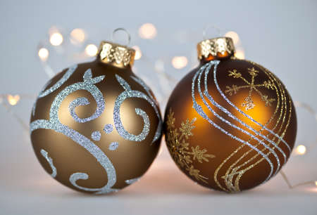 Two gold Christmas decorations with decorative lights on gray background Stock Photo - 16419121