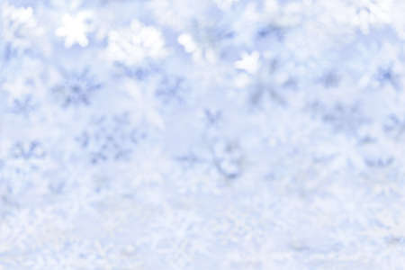 Blue abstract blurred Christmas background with snowflakes photo