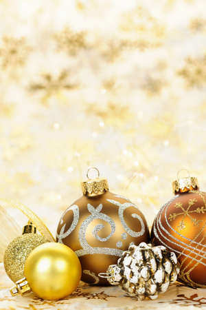 Golden Christmas background with gold balls and ornaments