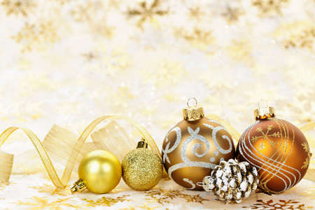 Golden Christmas background with gold balls and ornaments Stock Photo - 16419102