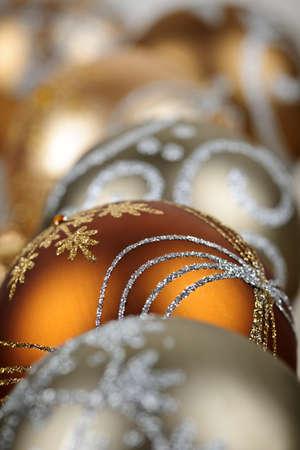 Closeup of golden Christmas balls with festive designs Stock Photo - 16419110
