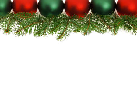 Row of green and red Christmas ornaments with tree branches photo
