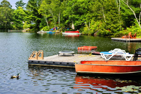 Beautiful lake with docks and diving platform in Ontario Canada cottage country Stock Photo - 16419308
