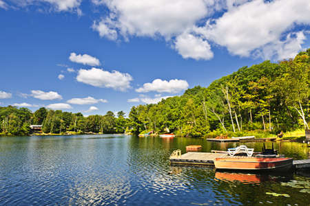 waterfront property: Beautiful lake with docks in Ontario Canada cottage country
