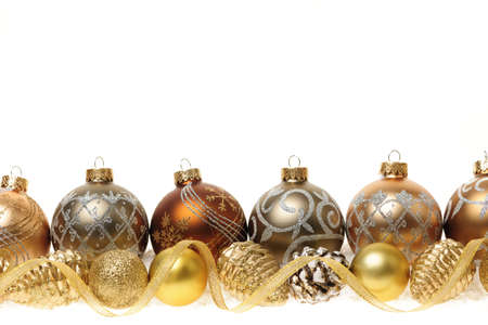 Golden Christmas decorations with gold balls and ornaments on white background Stock Photo - 16556720