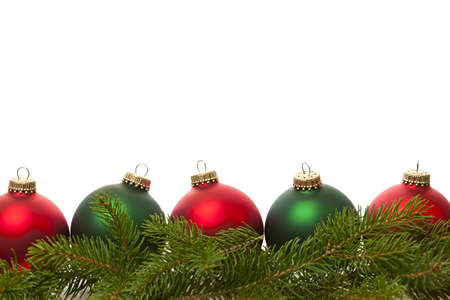 Row of green and red Christmas ornaments with pine tree branches photo
