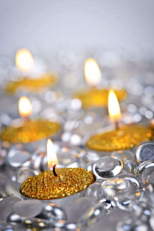 Burning golden decorative Christmas candles with glass beads Stock Photo - 16556721