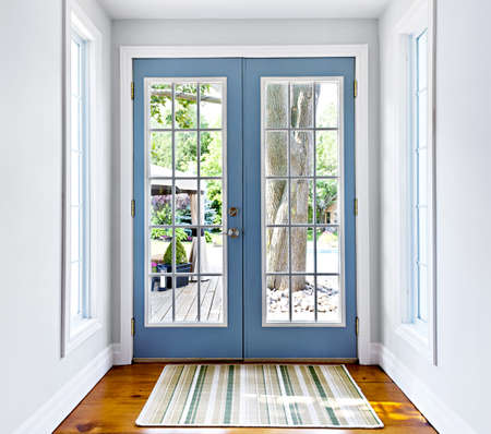 Double patio french doors with windows exiting to sunny backyard Stock Photo - 16524172
