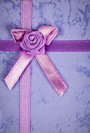 Pink gift ribbon and bow on present Stock Photo - 16556725