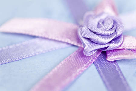 Closeup of pink gift ribbon and bow on present Stock Photo - 16556715