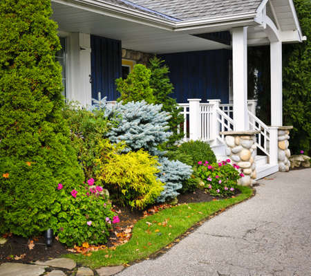 driveways: Front entrance of house with garden and porch Stock Photo