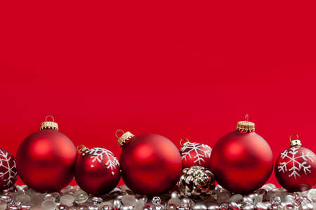 Red and silver Christmas decorations on crimson background Stock Photo - 16654684