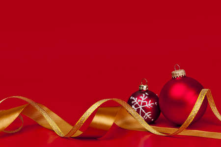 Red Christmas background with ornaments and gold ribbon Stock Photo - 16654688