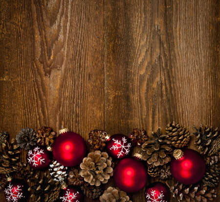 pine cones: Rustic wood background with Christmas ornaments and pine cones