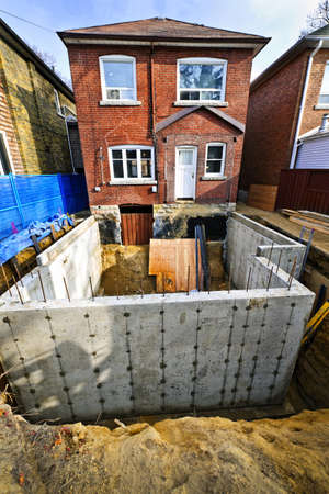 Building addition to residential house with new foundation photo