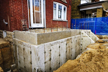 Building addition to residential house with new foundation Stock Photo - 16639373