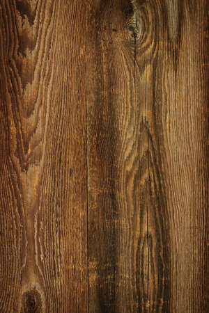 Brown rustic wood grain texture as background photo
