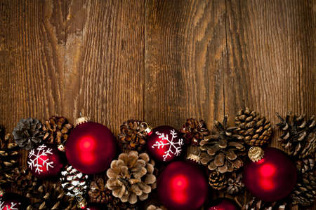 Rustic wood background with Christmas ornaments and pine cones Stock Photo - 16784834