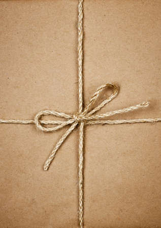 Gift package wrapped in brown paper tied with twine closeup Stock Photo - 16784835