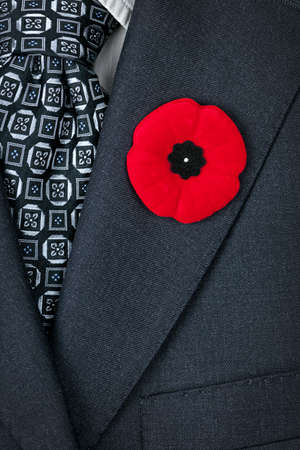 Red poppy lapel pin on suit jacket for Remembrance Day photo