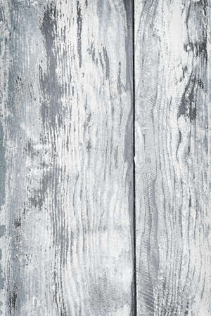 Textured background of distressed rustic wood with peeling blue and white paint photo
