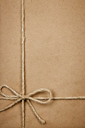 twine: Brown paper gift package background with twine and copy space