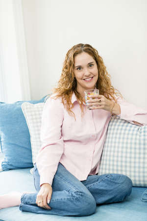 Smiling caucasian woman relaxing with glass of water Stock Photo - 17500459