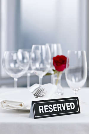 Reserved romantic table setting with roses plates and cutlery Stock Photo - 17570758
