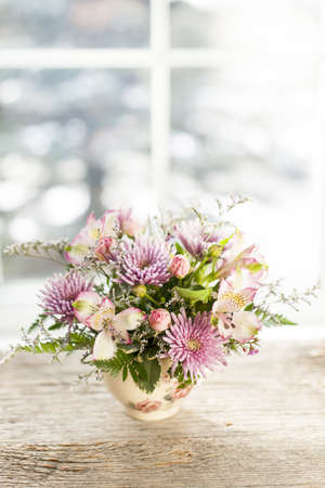 Bouquet of colorful flowers arranged in small vase Stock Photo - 17664243