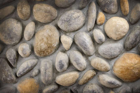 Wall of rocks and stones in cement background Stock Photo - 17664314