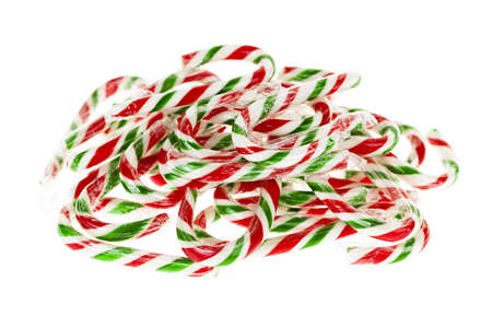 Pile of red and green Christmas candy canes isolated on white background Stock Photo - 18066125
