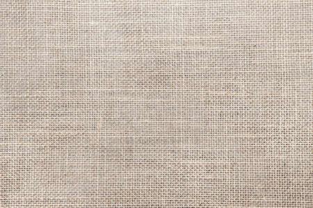 Rustic canvas fabric texture in natural color Фото со стока