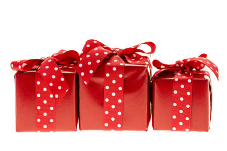 Three presents wrapped in red paper with polkadot ribbon Stock Photo - 18066154