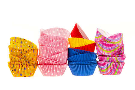 Several stacks of colorful muffin or cupcake cups isolated on white background Stock Photo - 18066143