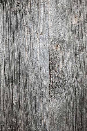 Weathered distressed rustic barn wood as textured background Stock Photo